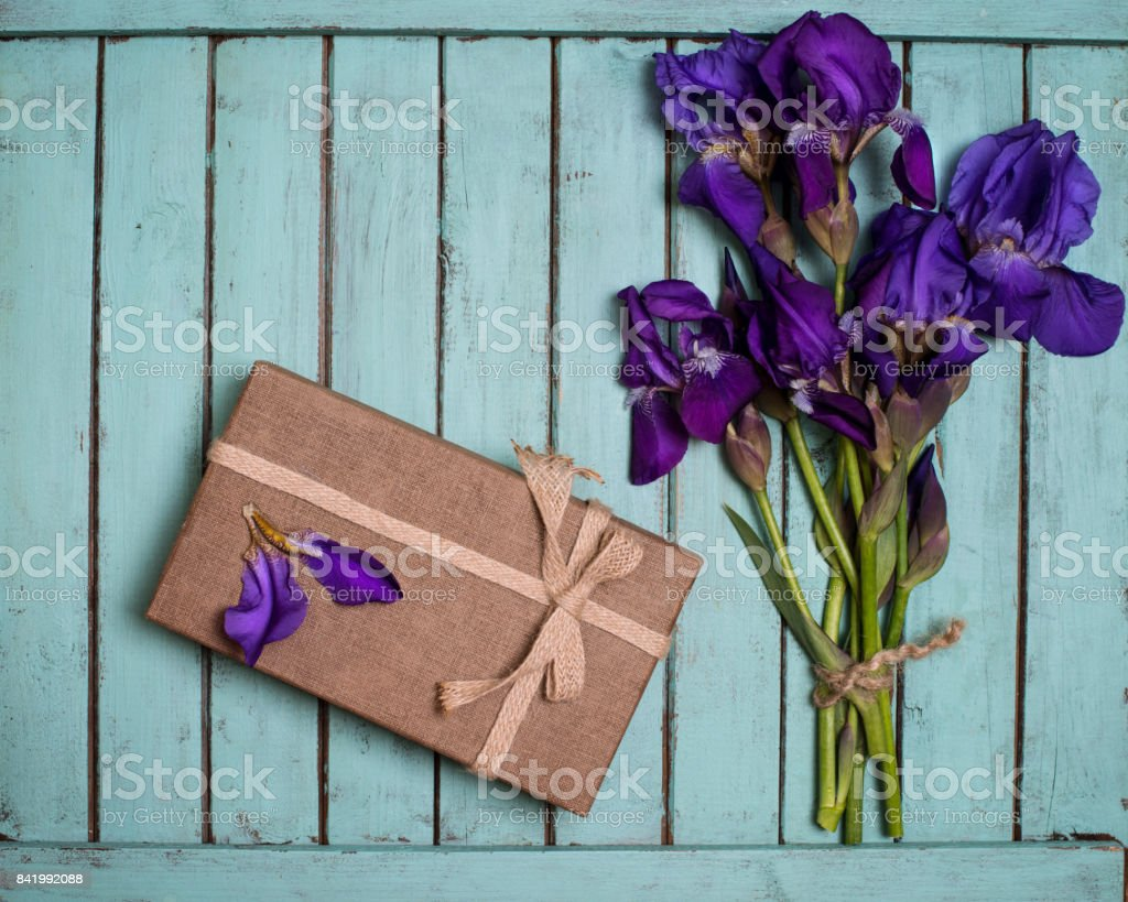 Purple Iris Flowers Bouquet And Gift Box On Shabby Chic Wooden