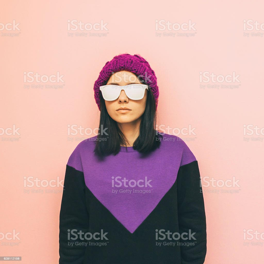 purple knitted hat and geometric sweater. stock photo
