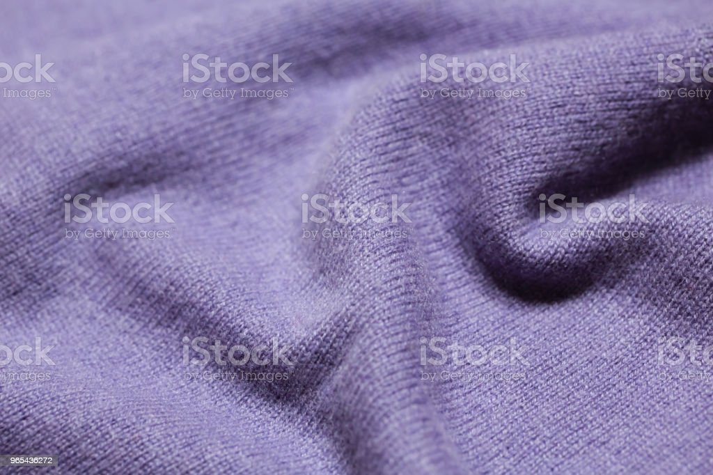 Purple knitted woolen background royalty-free stock photo