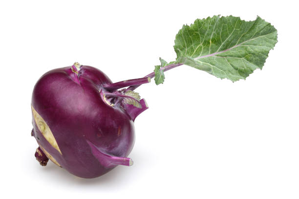 Purple kohlrabi with leaf on white background Purple kohlrabi with leaf isolated on white background brassica rapa stock pictures, royalty-free photos & images