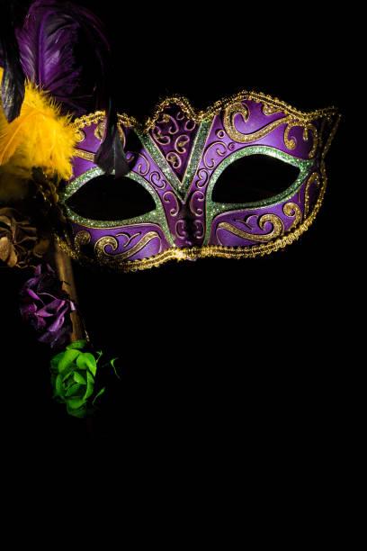 A purple mardi gras or venetian mask stock photo