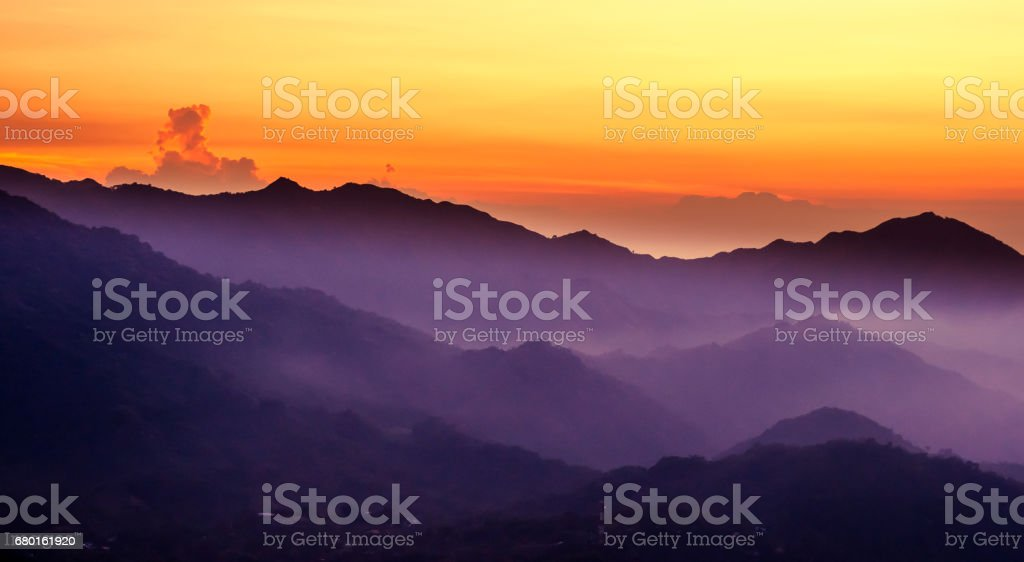 Purple mountain with sunset over Minca in Colombia stock photo