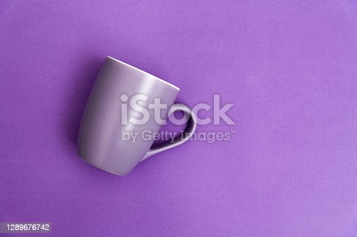 Purple mug on purple background.