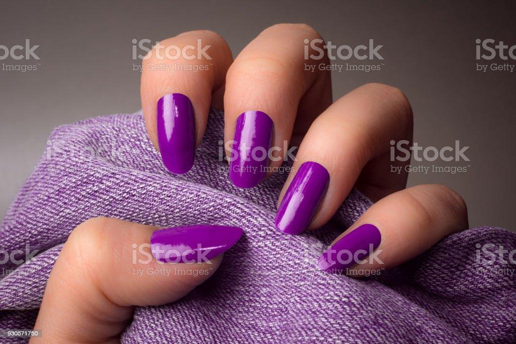purple nails manicure stock photo