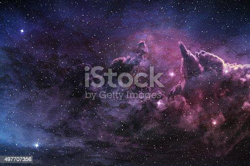 istock purple nebula and cosmic dust 497707356