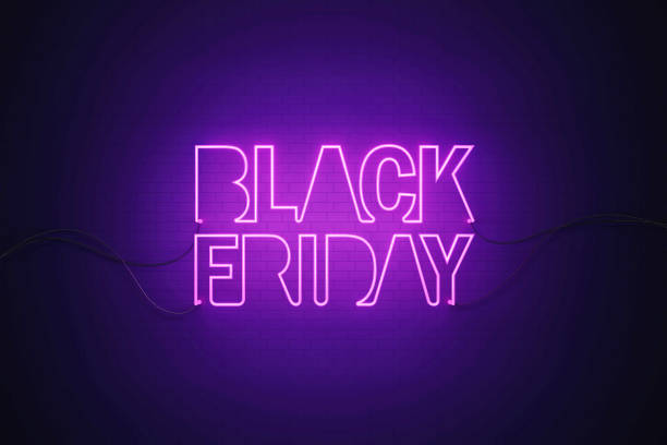 Purple Neon Light Writes Black Friday on Black Wall Purple neon light writes Black Friday on black wall. Horizontal composition with copy space. Black Friday concept. black friday sale neon stock pictures, royalty-free photos & images