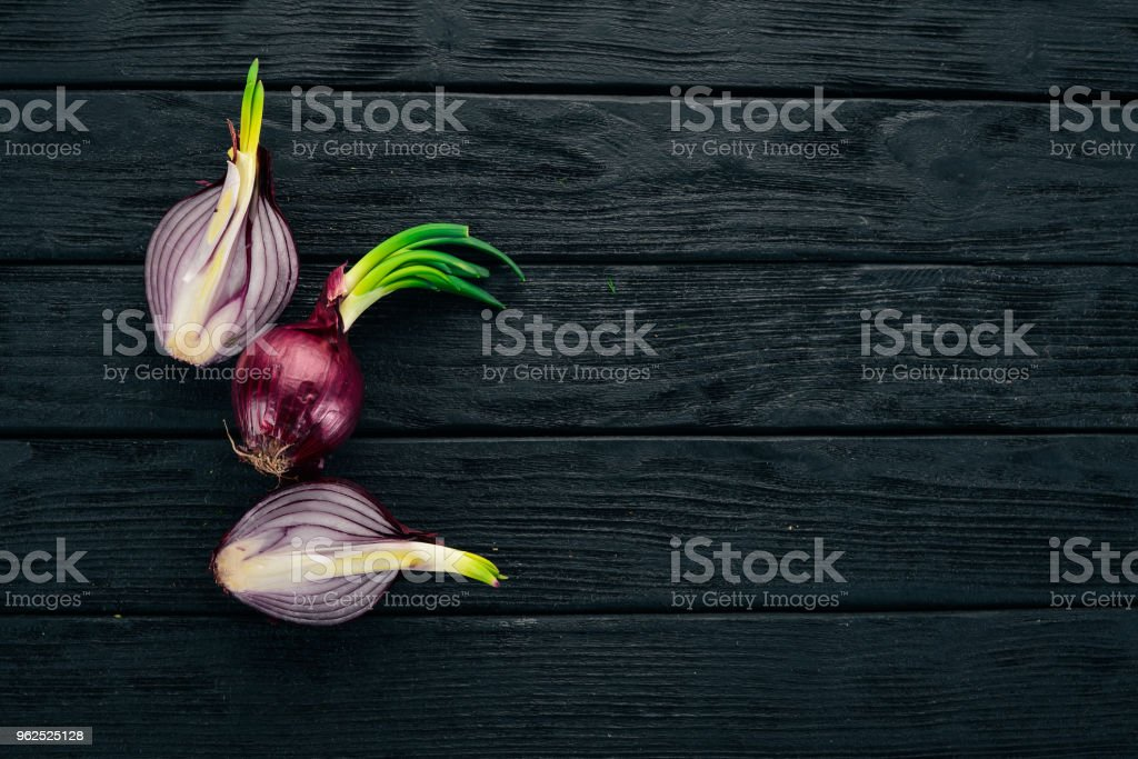 Purple Onion. On a black wooden background. Healthy food. Top view. Copy space. - Royalty-free Agriculture Stock Photo