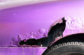 istock Purple or pink car broken side with damaged metal and hole, with rusty paint 908196726