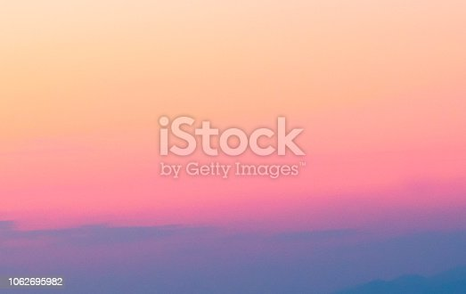 646012098istockphoto Purple orange and pink abstract  background 1062695982