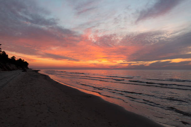 Purple orange sunset Baltic Sea and surf in autumn stock photo