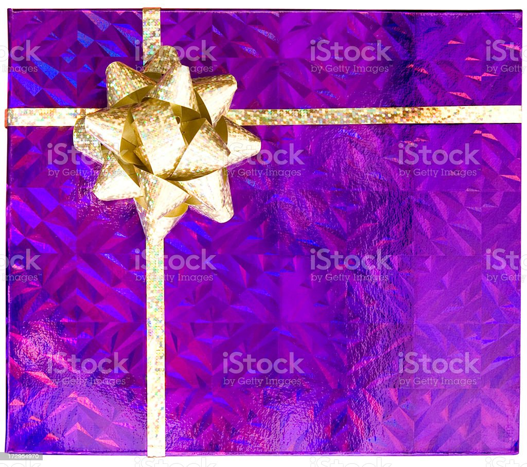 Purple parcel with gold bow royalty-free stock photo