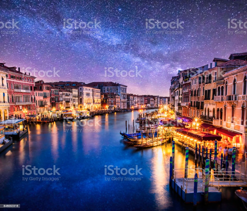 purple photo venecia venezia venice milkyway night ponte di rialto view clouds stock photo