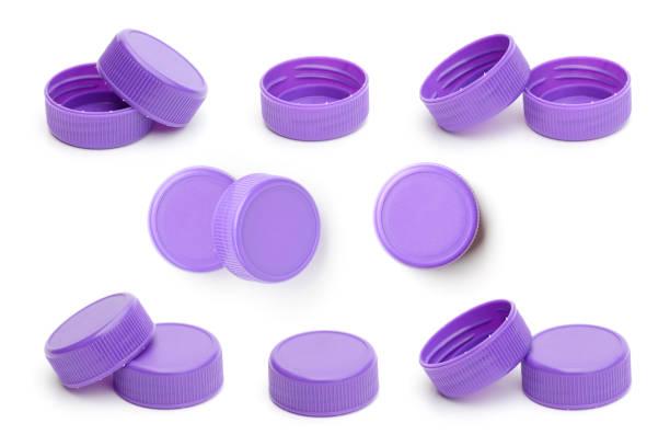 purple plastic bottle cap on white background - plastic cap stock photos and pictures