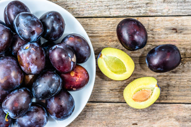 Purple plums, autumn fruits harvest stock photo