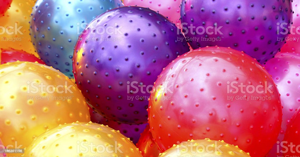 Purple Red Yellow Rubber Balls background royalty-free stock photo