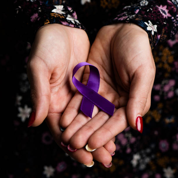 purple ribbon against the violence against women - domestic violence stock pictures, royalty-free photos & images