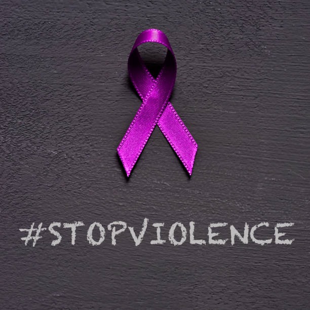 purple ribbon and text stop violence - domestic violence stock pictures, royalty-free photos & images