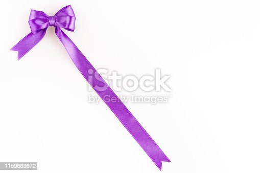 istock purple ribbon bow 1159669672
