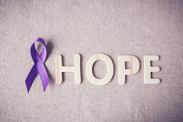 Purple ribbon with HOPE wooden letter, toning, Alzheimer's disea stock photo