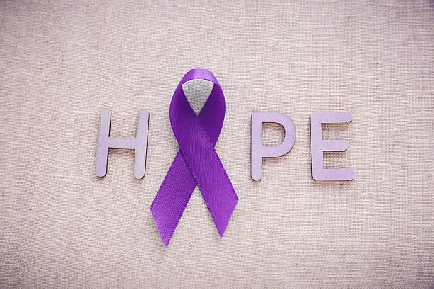 purple ribbons with hope word, alzheimer's disease, pancreatic c - violencia de genero fotografías e imágenes de stock