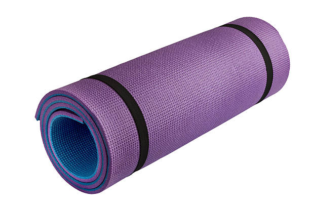 purple roll mat isolated over white close up of rolled purple roll mat isolated over white padding stock pictures, royalty-free photos & images