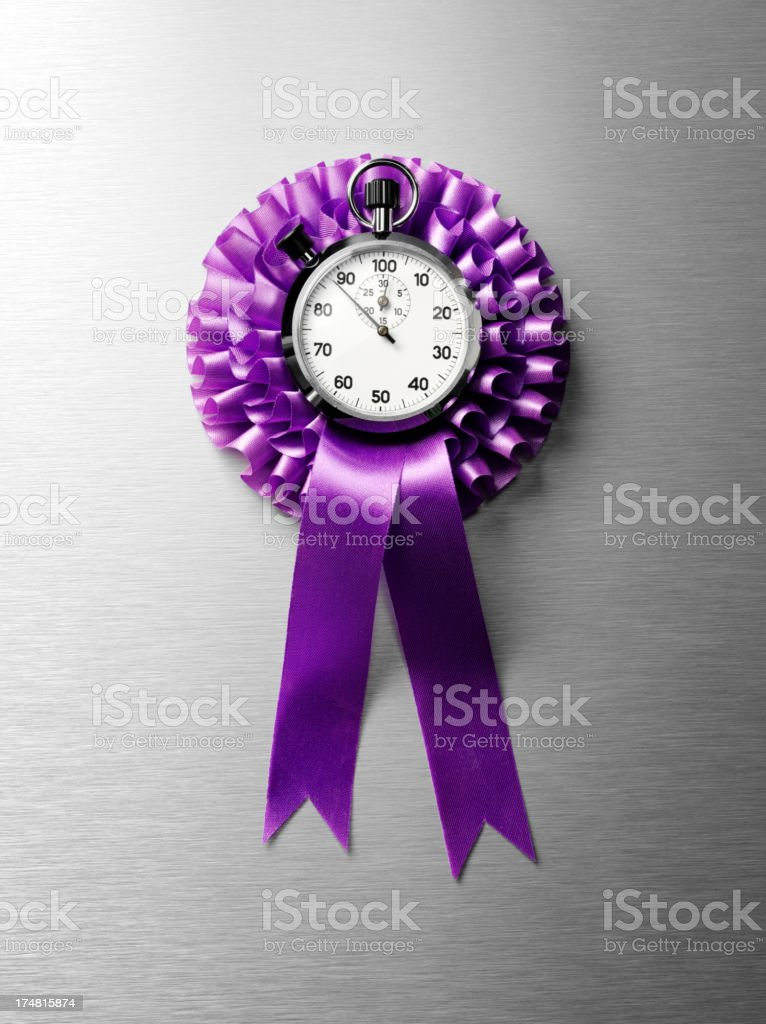 Purple Rosette and Stopwatch royalty-free stock photo