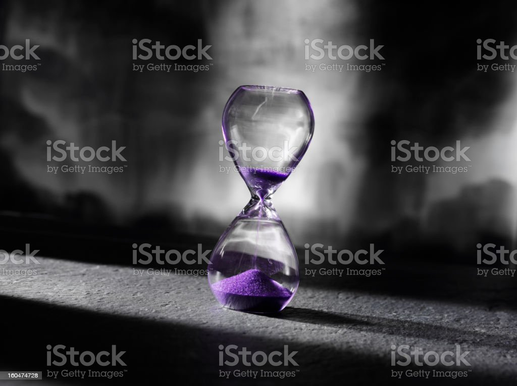 Purple Sand in a Hourglass royalty-free stock photo