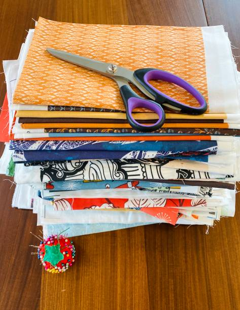 Purple Scissors On A Stack Of Fabric Samples stock photo