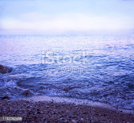 Sea waves background at the blue hour