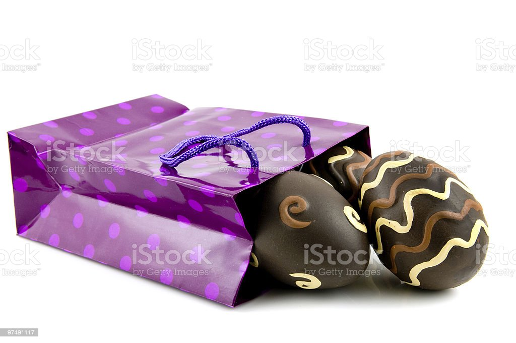 Purple shopping bag with easter eggs royalty-free stock photo