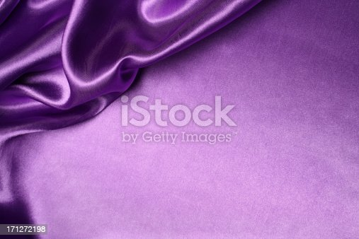 Purple silk background with blank space.