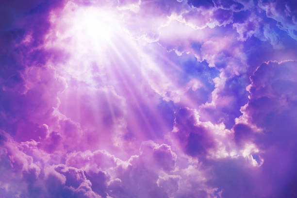 purple sky with sun and beautiful clouds - heaven stock photos and pictures