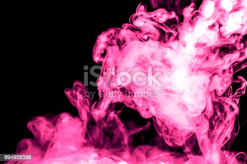 istock purple smoke isolated on a black background. fractal. spiral. 894958396