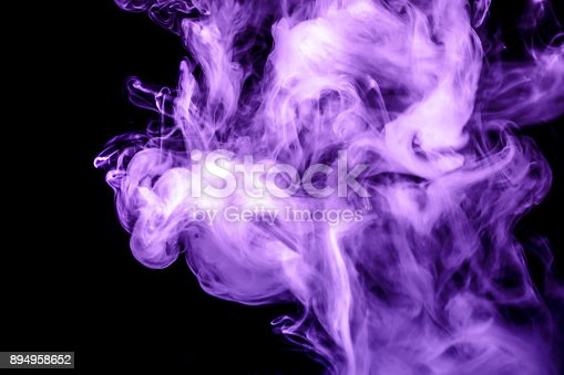 874895030istockphoto purple smoke isolated on a black background. fractal. spiral. 894958652