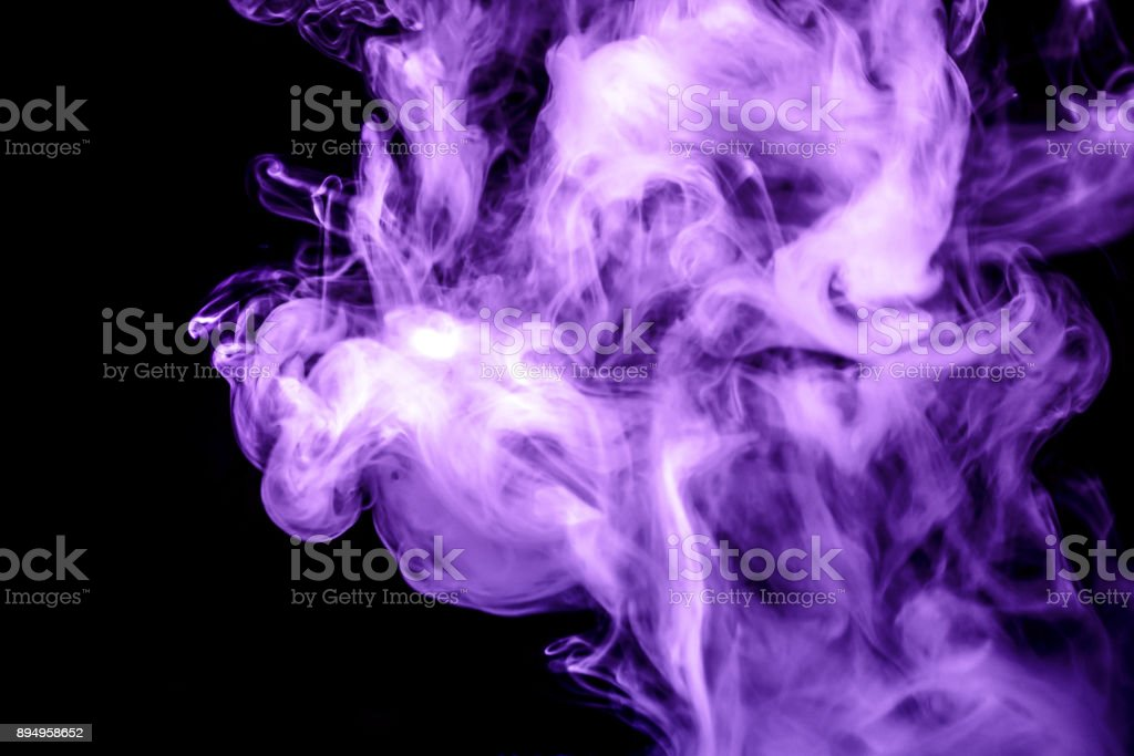 purple smoke isolated on a black background. fractal. spiral. stock photo