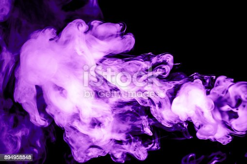 874895030istockphoto purple smoke isolated on a black background. fractal. spiral. 894958848