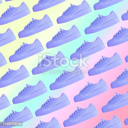 1125575814 istock photo purple sneakers. Awesome pattern on rainbow gradient background 1143723245