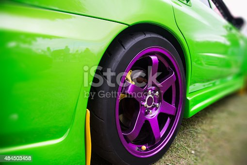 Green Sport Car with purple alloy wheel