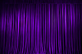 Purple stage curtains full frame.