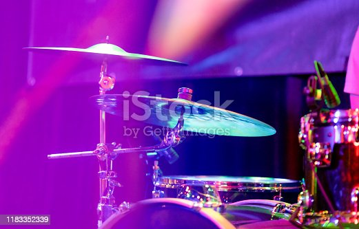 Purple stage light on the drums