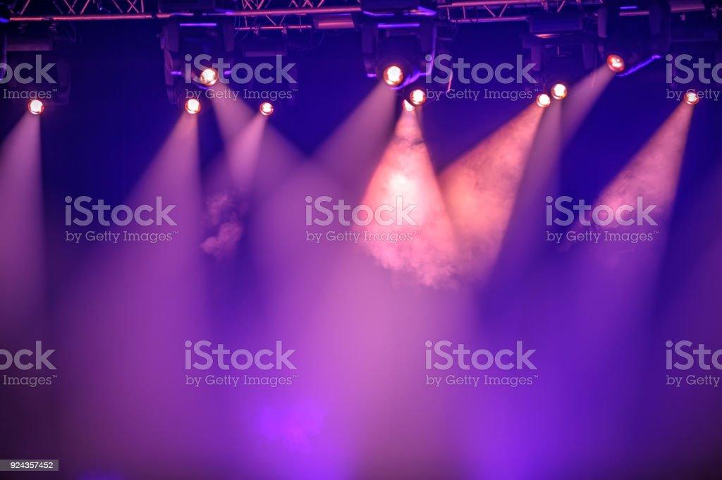 Purple stage spotlights stock photo