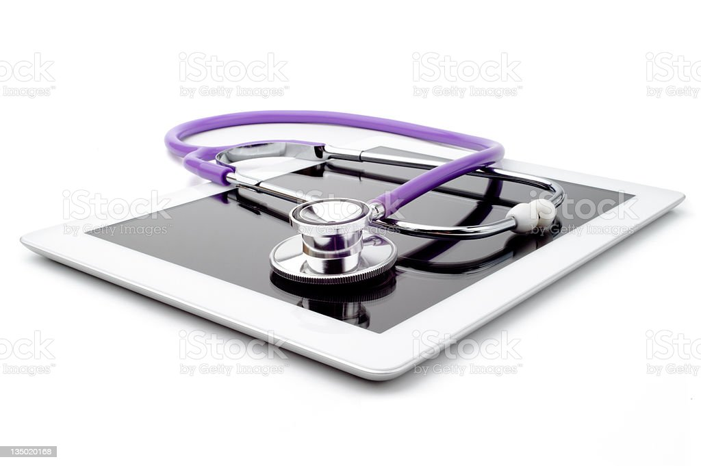 Purple stethoscope on top of white digital tablet royalty-free stock photo