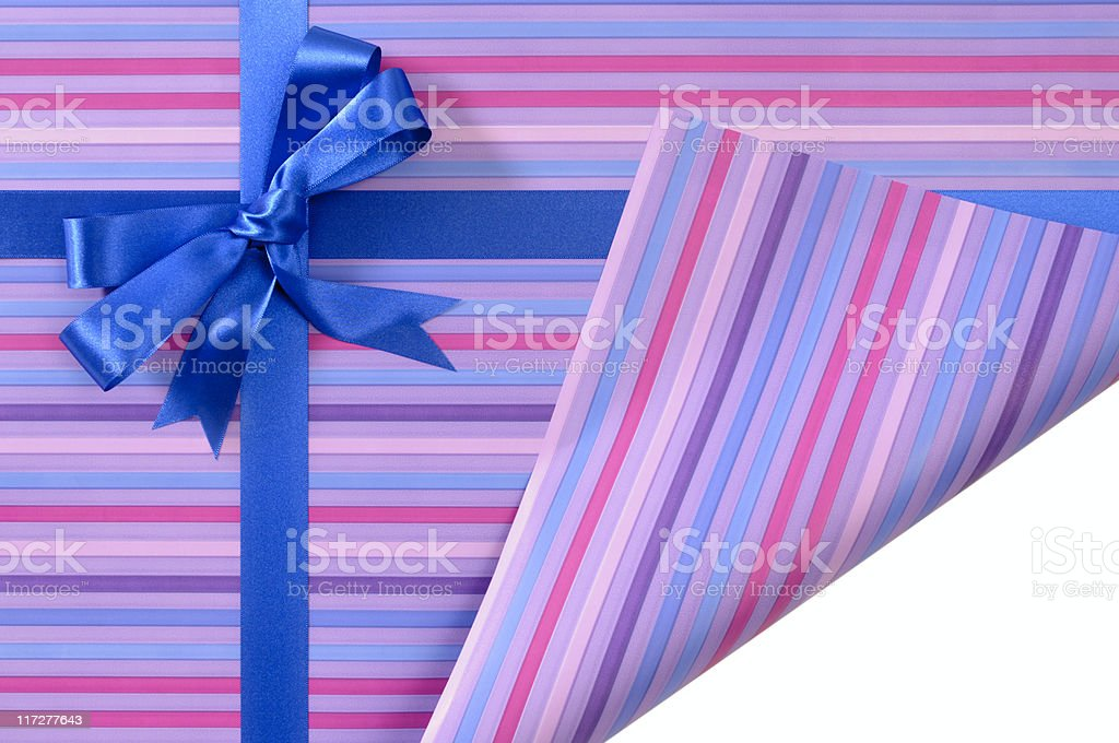 Purple striped gift with curled corner royalty-free stock photo