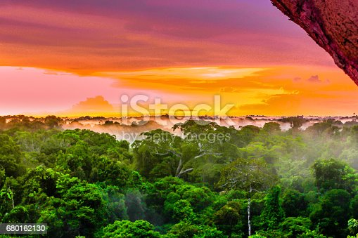 istock Purple sunset over rainforest by Leticia in Colombia 680162130