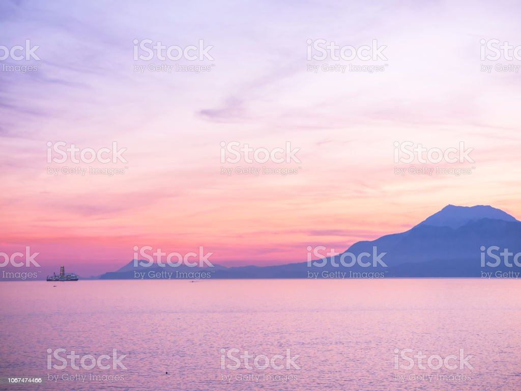 Purple Sunset Sky Over The Blue Sea Stock Photo Download Image Now Istock