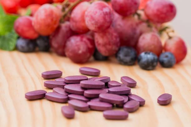 Purple supplements. stock photo