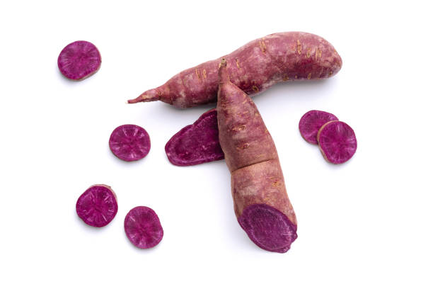 Purple Sweet Potato Agricultural Tuber and Slices stock photo