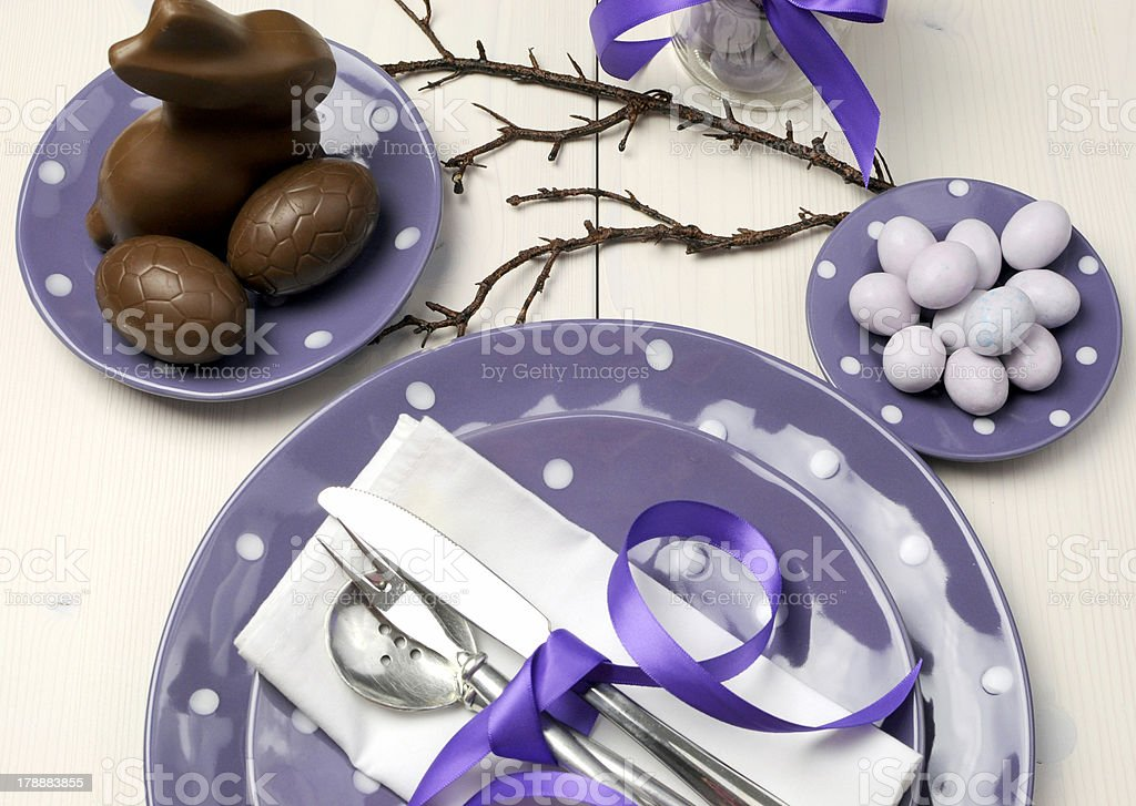 Purple theme Easter dining table setting royalty-free stock photo