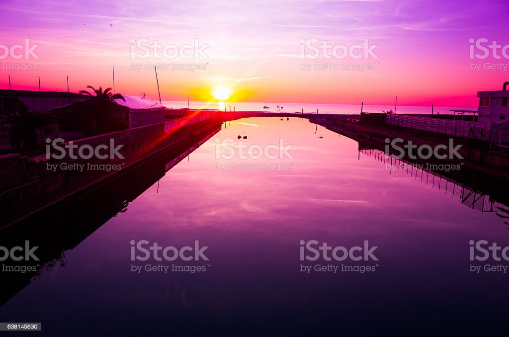 Purple  toned  sunset in italy stock photo