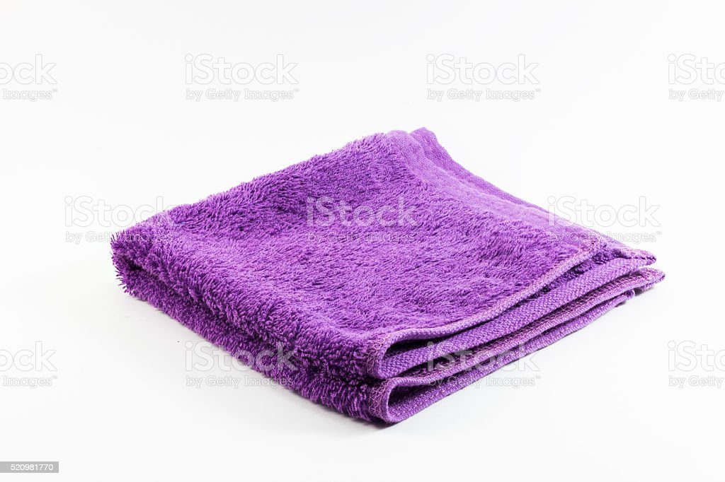 Purple towel handkerchief isolated on white background stock photo